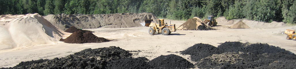 Biosolids, wood waste and sand are combined to create a fabricated soil which can be custom designed to the intended application.