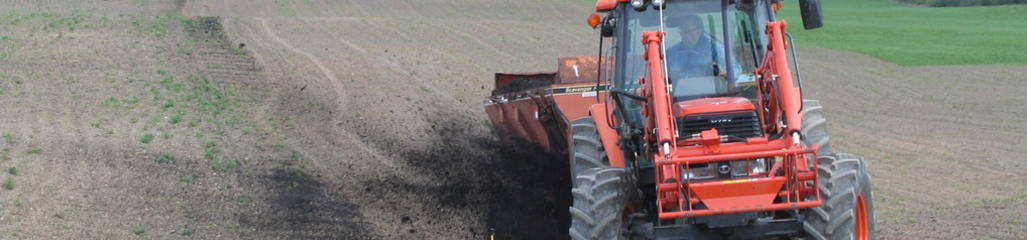 Ash applications to agricultural land enhance crop growth by modifying soil pH.